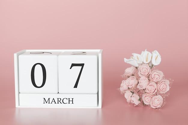 07 de março. dia 7 do mês. cubo de calendário na rosa moderna