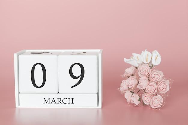 09 de março. dia 9 do mês. cubo de calendário na rosa moderna
