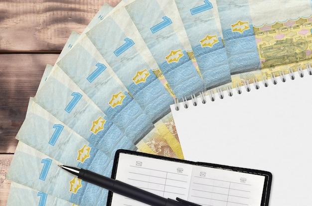 1 ventilador de notas de hryvnia ucraniano e bloco de notas com livro de contatos e caneta preta