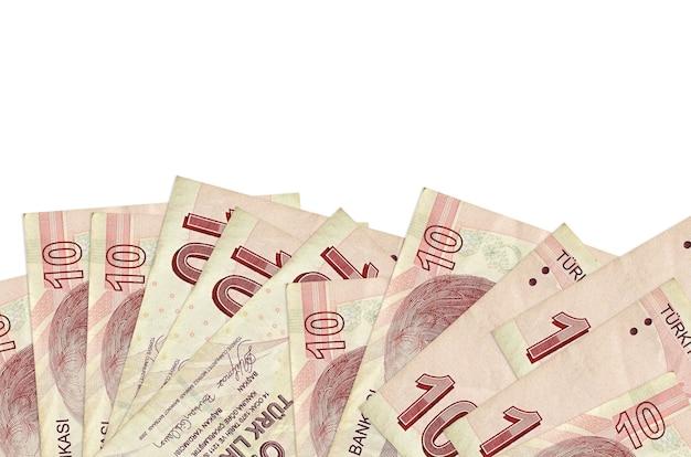 10 contas de liras turcas encontram-se na parte inferior da tela de fundo isolado com espaço de cópia.