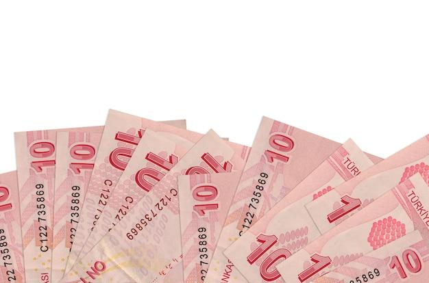 10 contas de liras turcas encontram-se na parte inferior da tela, isolada na parede branca com espaço de cópia.