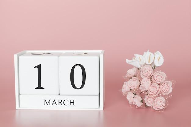10 de março. dia 10 do mês. cubo de calendário na rosa moderna