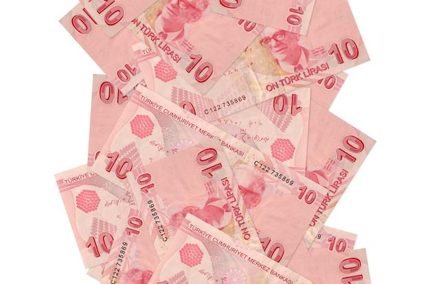 10 notas de liras turcas voando baixo isoladas no branco. muitas notas caindo com espaço de cópia em branco no lado esquerdo e direito