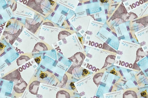 1000 contas de hryvnias ucranianas estão na grande pilha