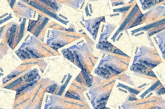 1000 notas de riels cambojanos estão na pilha grande