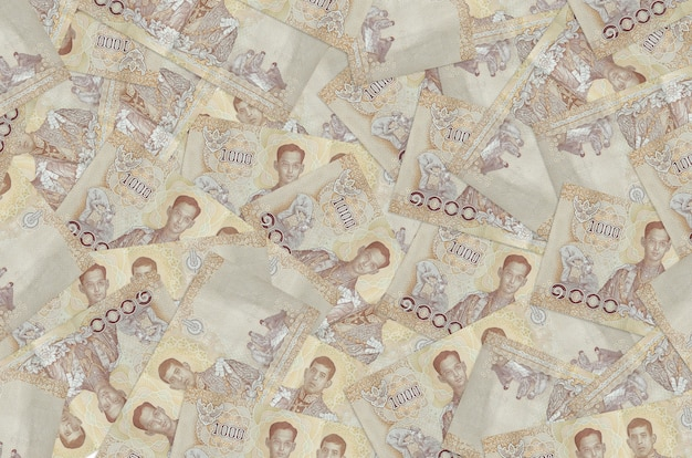 1000 notas do baht tailandês estão na pilha grande. parede conceitual de vida rica. grande quantidade de dinheiro
