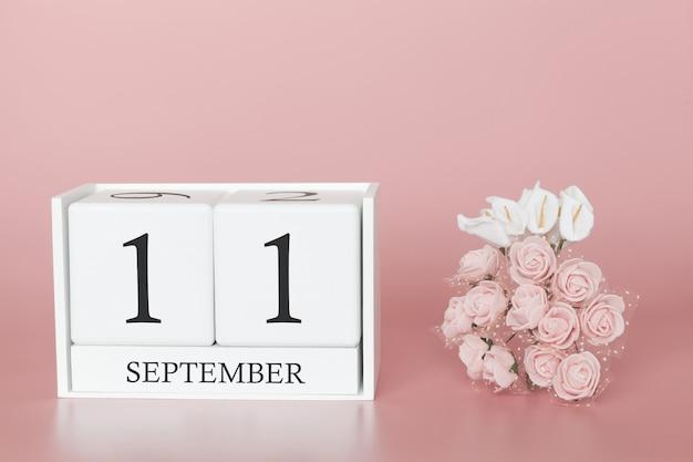 11 de setembro. dia 11 do mês. calendar o cubo no fundo cor-de-rosa moderno, no conceito do negócio e em um evento importante.