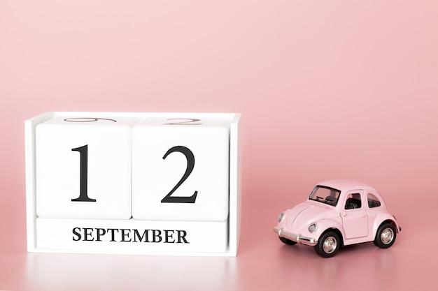 12 de setembro. dia 12 do mês. cubo de calendário com carro