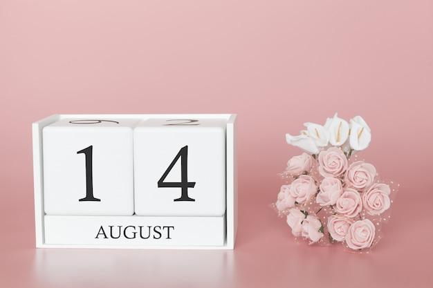 14 de agosto dia 14 do mês. calendar o cubo no fundo cor-de-rosa moderno, no conceito do negócio e em um evento importante.