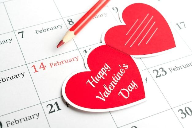 14 de fevereiro, dia dos namorados. cartão de felicitações e um lápis no calendário