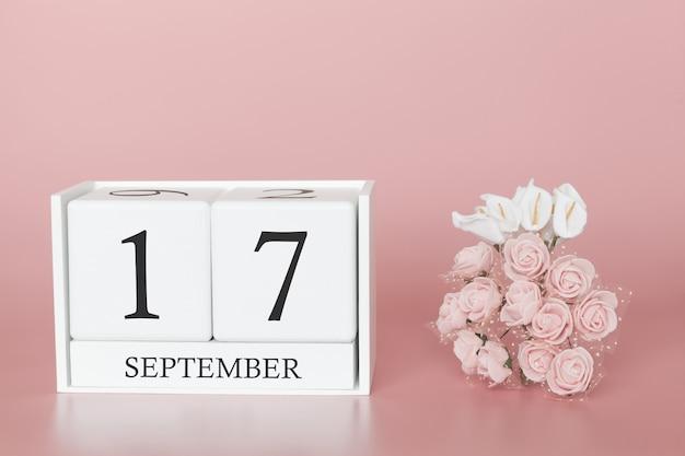 17 de setembro. dia 17 do mês. calendar o cubo no fundo cor-de-rosa moderno, no conceito do negócio e em um evento importante.