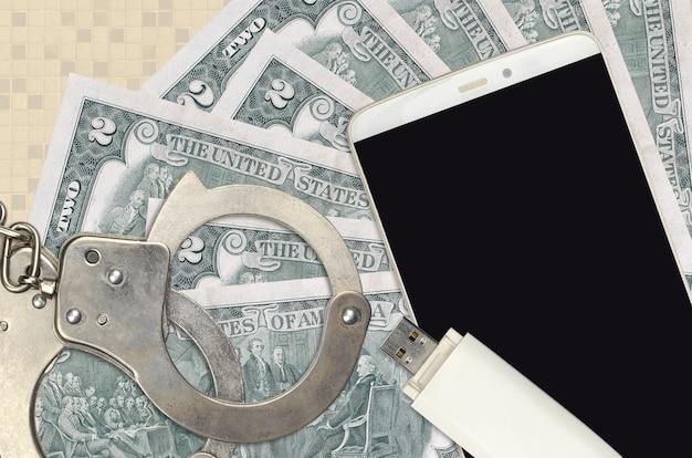 2 notas de dólares americanos e smartphone com algemas policiais