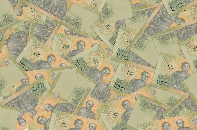 20 notas de baht tailandês encontram-se na pilha grande. informações básicas conceituais da vida rica. grande quantidade de dinheiro