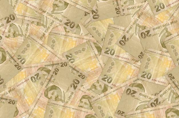 20 notas de liras turcas encontram-se na pilha grande. parede conceitual de vida rica. grande quantidade de dinheiro