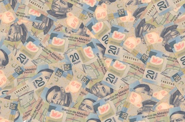 20 notas de pesos mexicanos estão na pilha grande. informações básicas conceituais da vida rica. grande quantidade de dinheiro