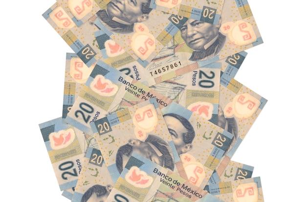 20 notas de pesos mexicanos voando isoladas no branco