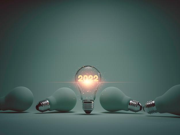 2022 anos brilhando dentro da lâmpada entre outros anos para 2022 novo conceito de ideia de negócio pela técnica de renderização em 3d.