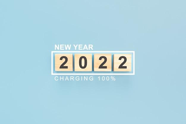 2022 em cubos de madeira fundo de ano novo ano de 2022 escrito em cubos de madeira cobrando ano novo