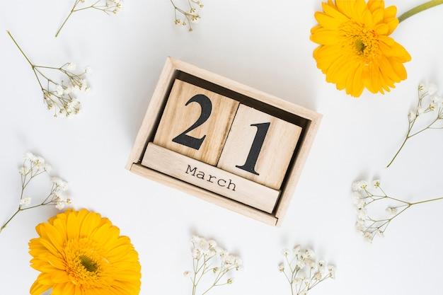 21 de março inscrição com flores gerbera
