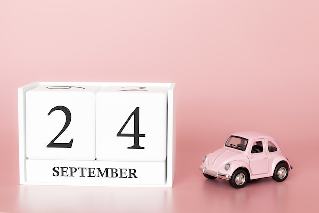 24 de setembro. dia 24 do mês. cubo de calendário com carro