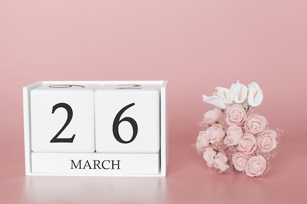 26 de março dia 26 do mês. cubo de calendário na rosa moderna