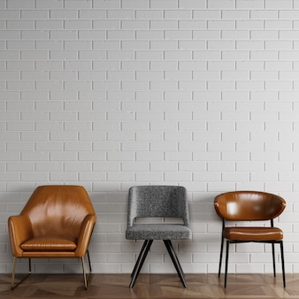3 cadeiras diferentes em estilo moderno, em frente a parede de tijolos brancos com copyspace