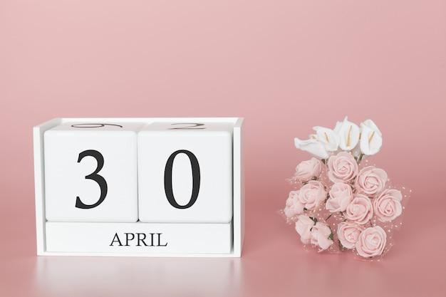 30 de abril. dia 30 do mês. cubo de calendário na rosa moderna