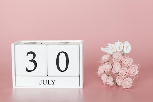 30 de julho. dia 30 do mês. cubo de calendário na rosa moderna