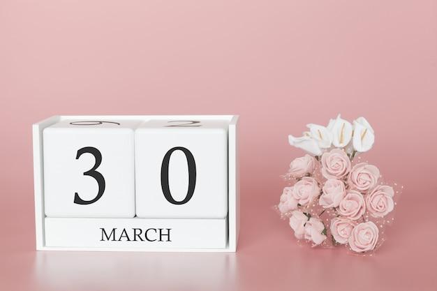 30 de março. dia 30 do mês. cubo de calendário na rosa moderna