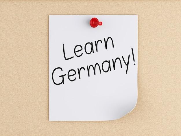3d aprenda alemanha, palavra no post-it sobre a cortiça.