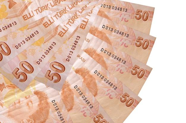 50 notas de liras turcas isoladas em um fundo branco com espaço de cópia empilhados em forma de leque.