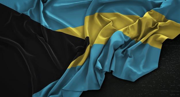 A bandeira das bahamas enrugada no fundo escuro 3d render