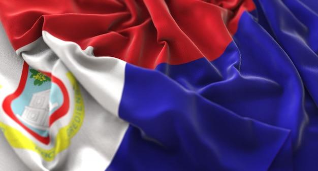 A bandeira de saint martin ruffled beautifully waving macro close-up shot