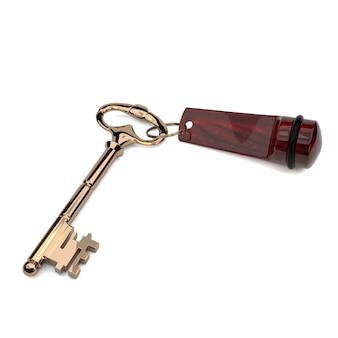 A chave dourada no keychain vermelho do estilo antigo isolado no fundo branco.