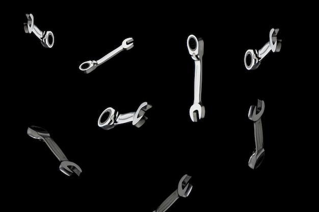A composição das chaves em ferramentas de um conceito de fundo preto para reparar motores.