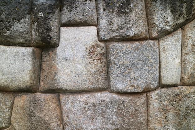 A enorme muralha da cidadela de sacsayhuaman, pedra única do antigo inca cusco, peru