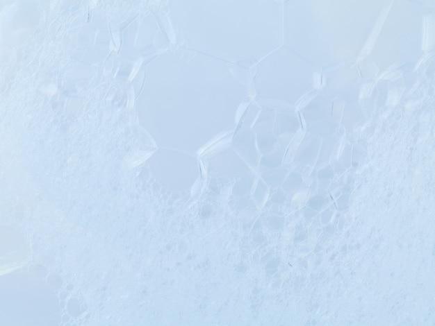 A estrutura da espuma borbulha textura abstrata no fundo branco.