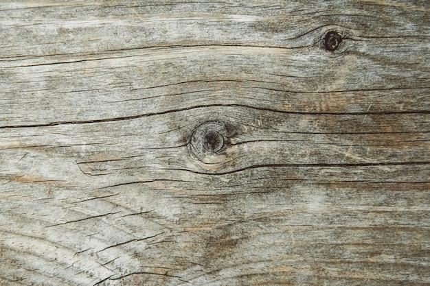 A estrutura do antigo tabuleiro. superfície com fissuras e nós. linhas e padrões visíveis.