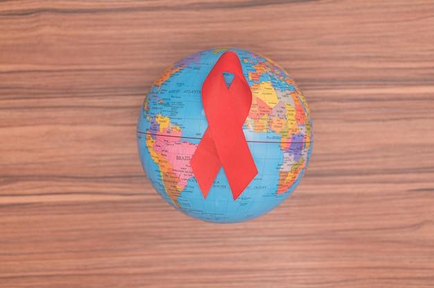 A fita vermelha simboliza o dia mundial da saúde