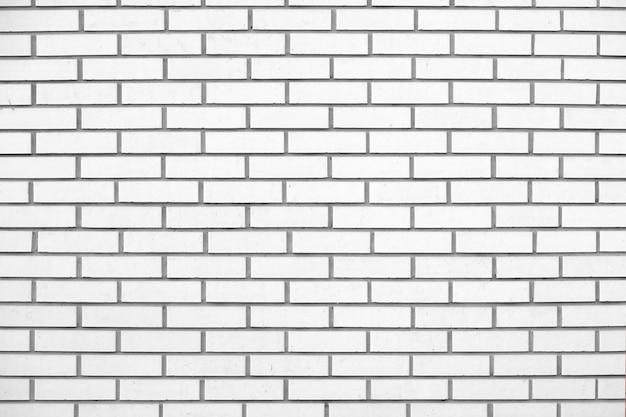 A grande parede de textura de tijolos vermelhos