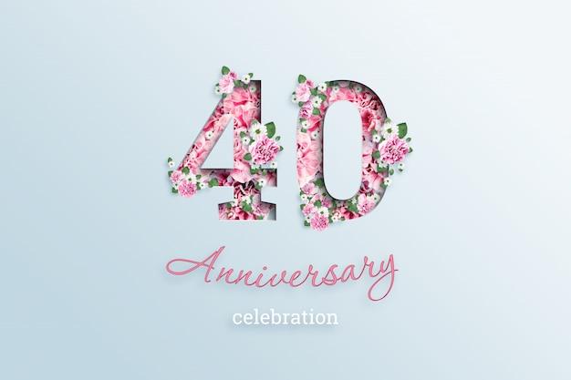 A inscrição 40 número e aniversário celebração textis flores, em uma luz.