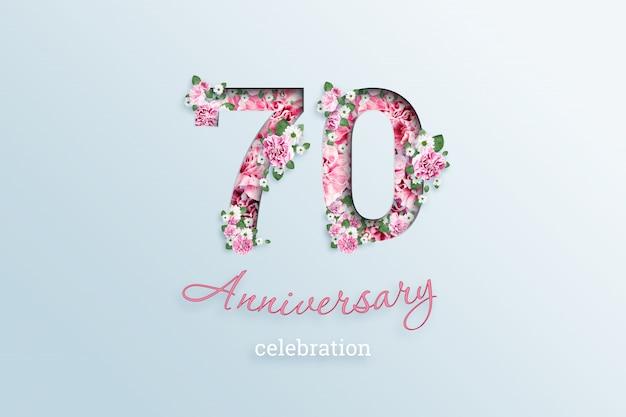 A inscrição 70 número e aniversário celebração textis flores, em uma luz