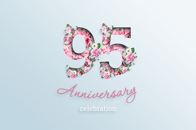 A inscrição 95 número e aniversário celebração textis flores, em uma luz