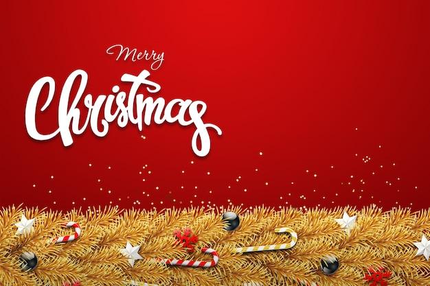 A inscrição de um feliz natal, galhos dourados de uma árvore de natal com bolas, doces, flocos de neve e estrelas.