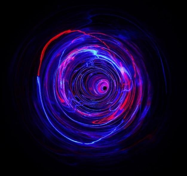 A luz colorida move a forma do ciclo em filmagem de longa exposição no escuro.
