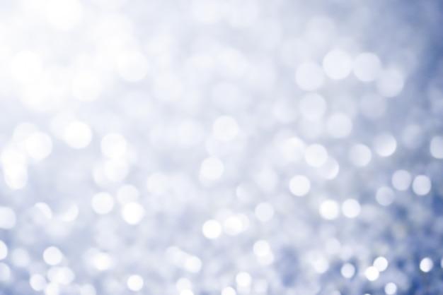 A luz do sumário da textura do fundo do bokeh do natal stars estrelas brilhantes no bokeh.