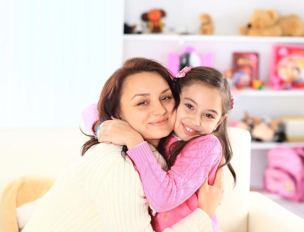 A mãe com sua filha.