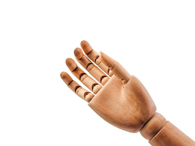 A mão da boneca de madeira faz os dedos para tocar no bakground branco