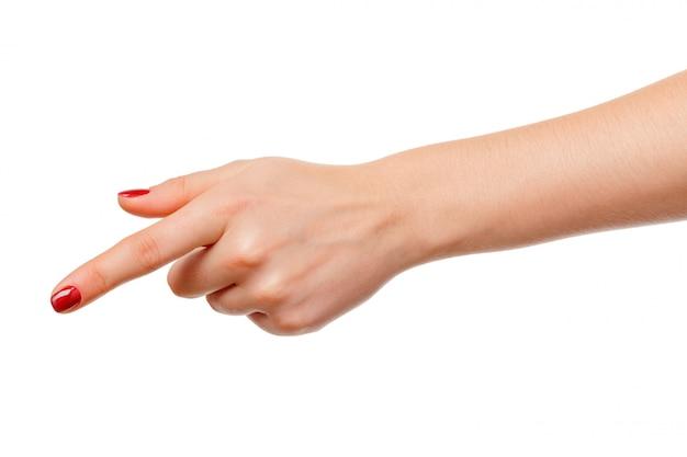 A mão da mulher aponta um dedo para algo isolado no fundo branco