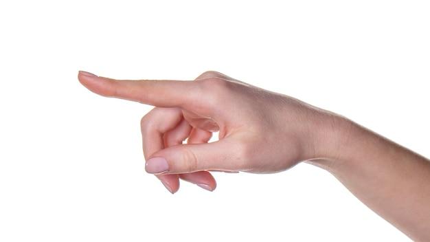 A mão de uma mulher aponta o dedo para algo isolado no branco. linguagem corporal.